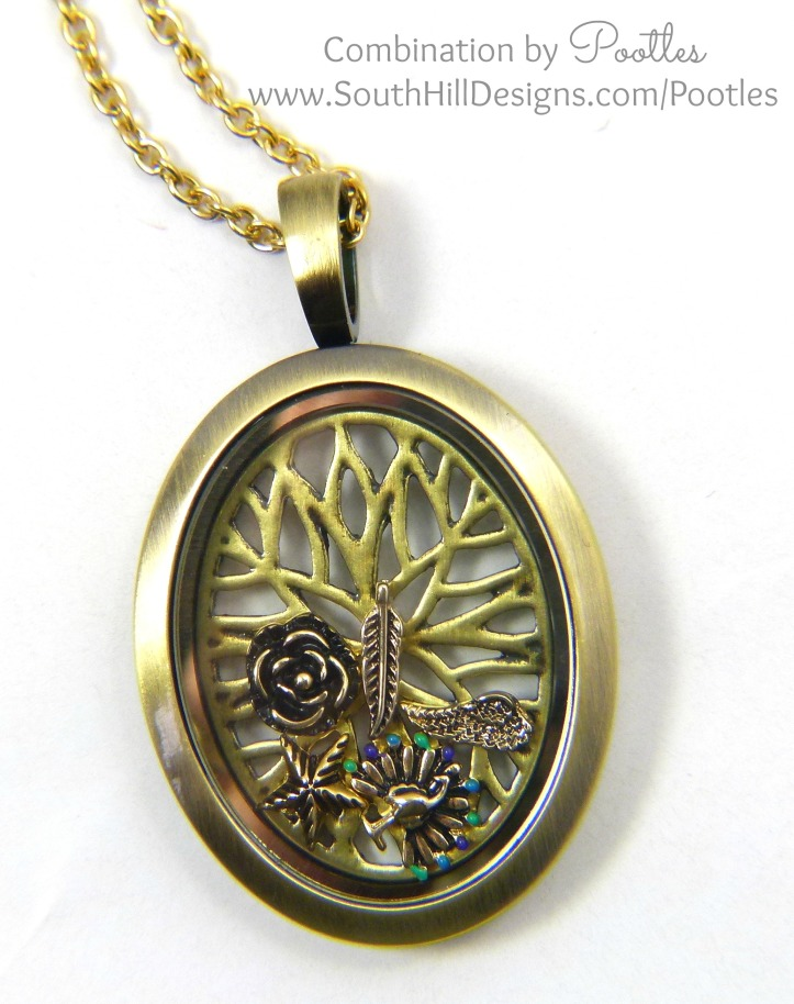 Pootles South Hill Designs - Vintage Oval Locket with Golden Charms close up