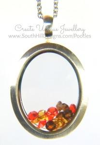 South Hill Designs - Orange Oval Showcase